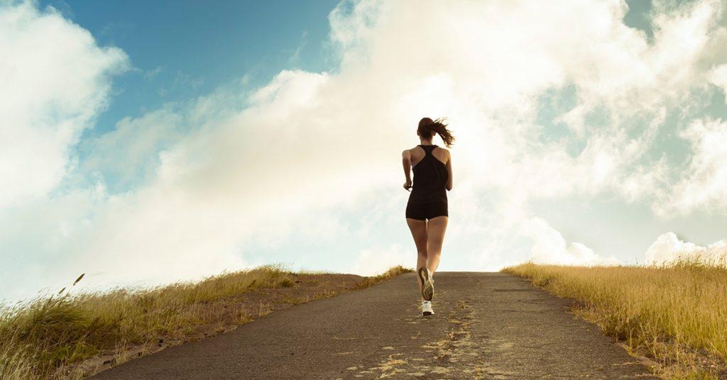 A woman running uphill