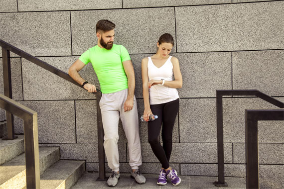 couple checking a step tracker