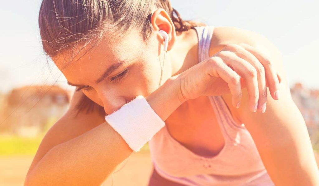 A woman struggling to run in the hot weather