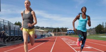 Two women racing on a running track