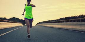 women running wearing a running gps watch