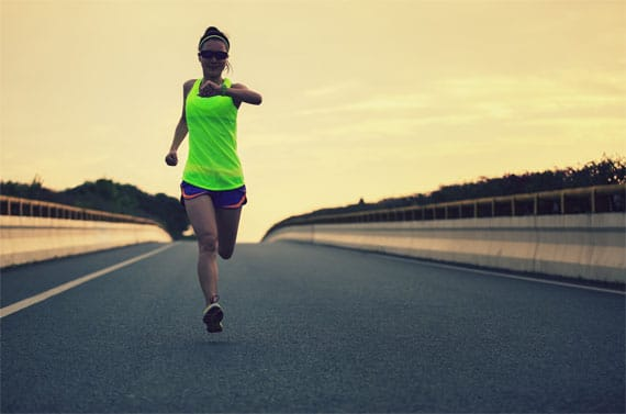 women running wearing a running gps watch