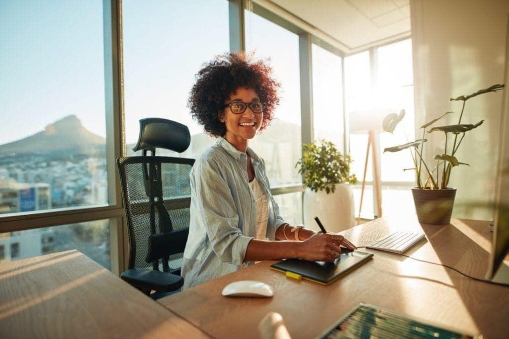 A young woman with good posture sat in her office