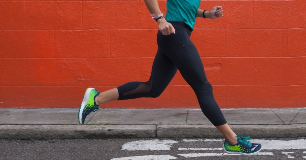A female runner running down the road