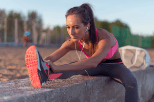 A female runner stretching out her hamstrings before she starts to run