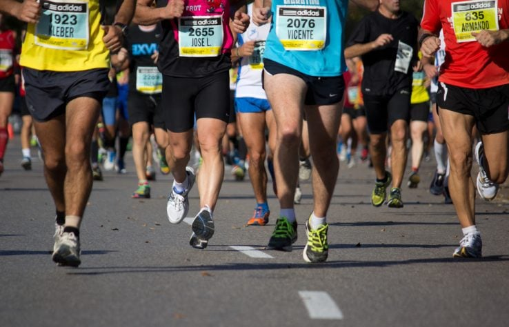 A group of runner running in a half marathon