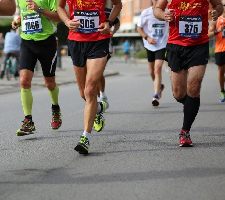 A group of runners running in a 5k marathon