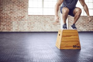 A man doing plyometric exercises in the gym