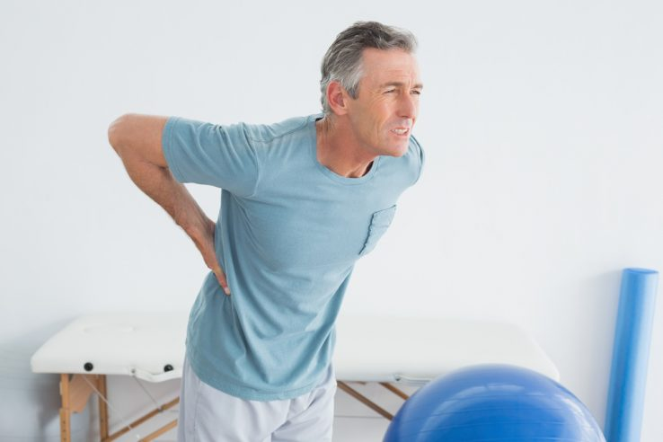 A man in the hospital with lower back pain