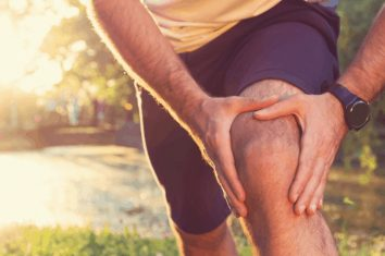 A man stretching out his sore knee
