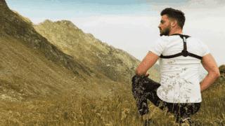 A man wearing a posture corrector