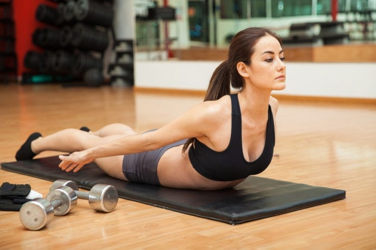 A woman doing core exercises in the gym