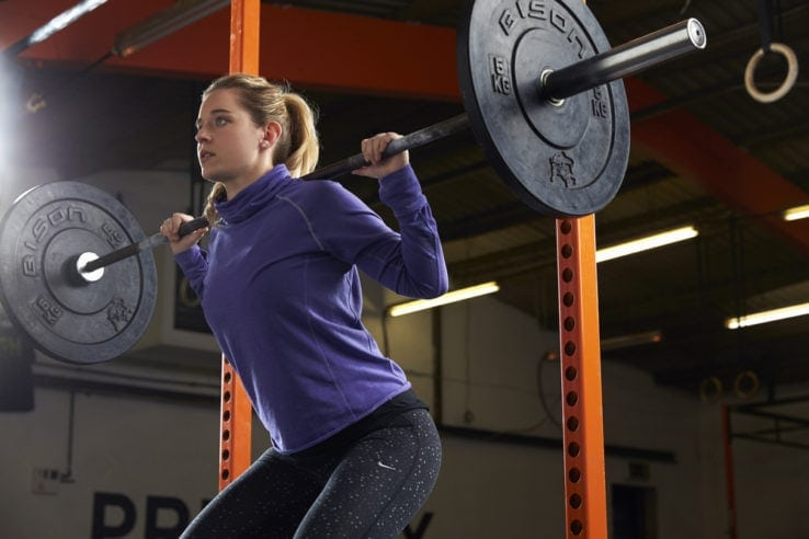 A woman in the gym doing squat exercises