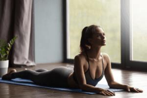 A woman performing a cobra yoga pose