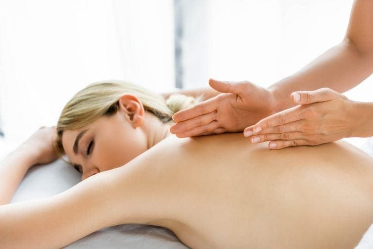 A woman receiving a massage in her home
