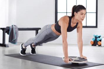 A woman using a balance board