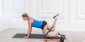 A woman warming up with a resistance band