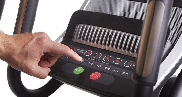 Close up of a stair stepper machine that has different programs