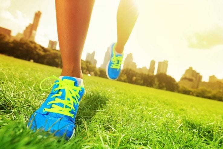 Close up of a woman wearing running shoes
