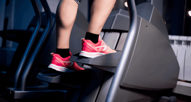 Close up of a womans feet using a stair stepper