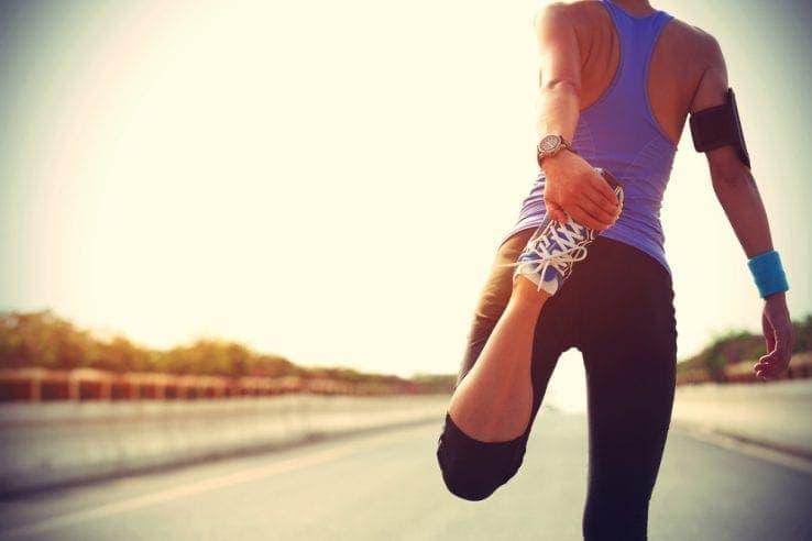 Female runner stretching her legs