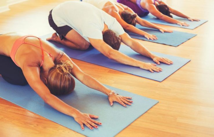 Group of people practicing yoga
