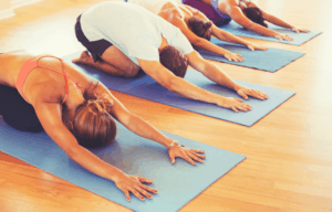 Multiple people doing the same pose during a yoga class