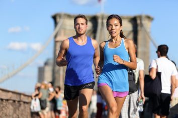 Two young runners running together