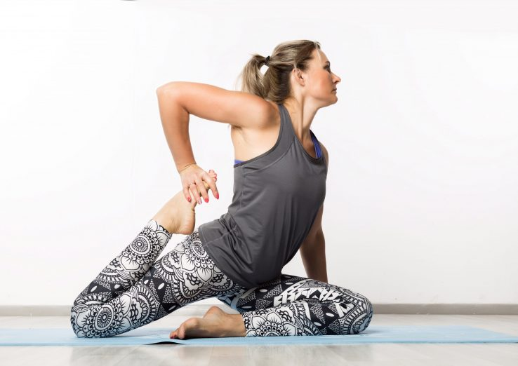 fitness woman doing Pigeon Stretches