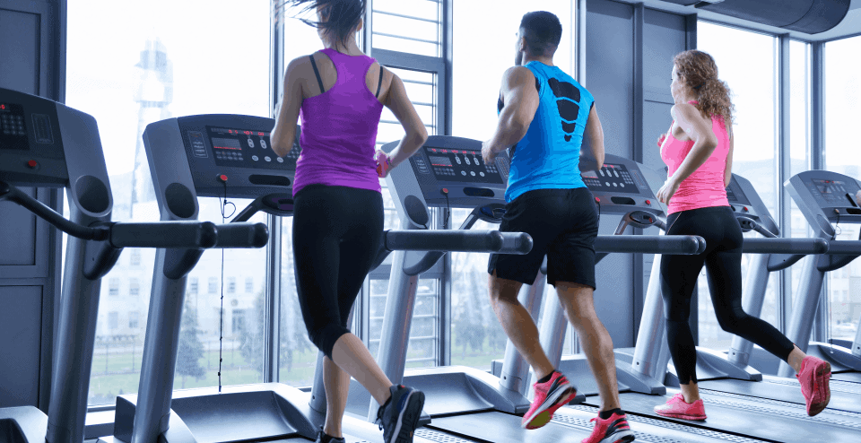 3 people running on treadmills together in the gym