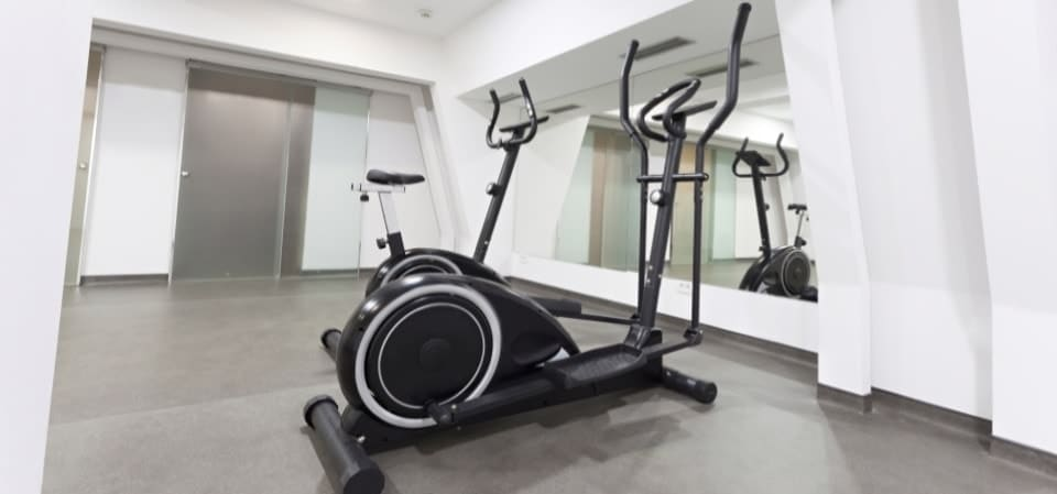 Elliptical trainer in exercise room