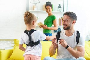 a girl and man using posture correctors featured image
