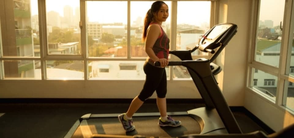A girl exercising on a treadmill