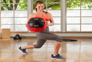 a girl exercising with a medicine ball