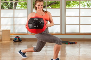 a girl exercising with a medicine ball