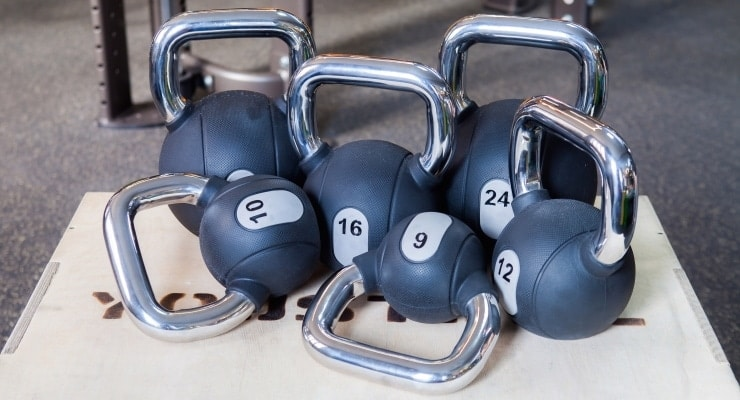 a group of different sizes of kettlebells