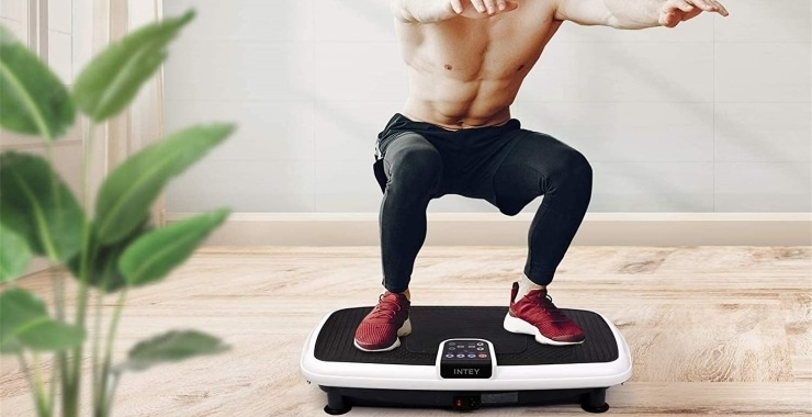 a man working out with a vibration machine