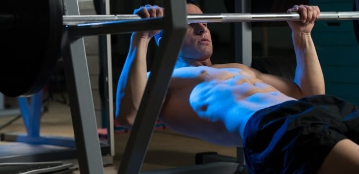 a man exercising back on horizontal barbell pull up