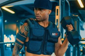 a man dressed in weighted vest featured image