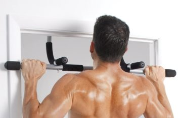 A man doing pull-ups on a doorway pull-up bar