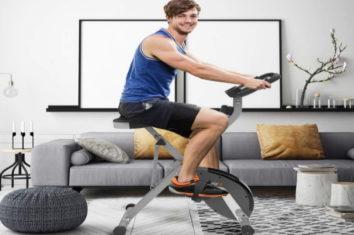 A man exercising on a folding bike