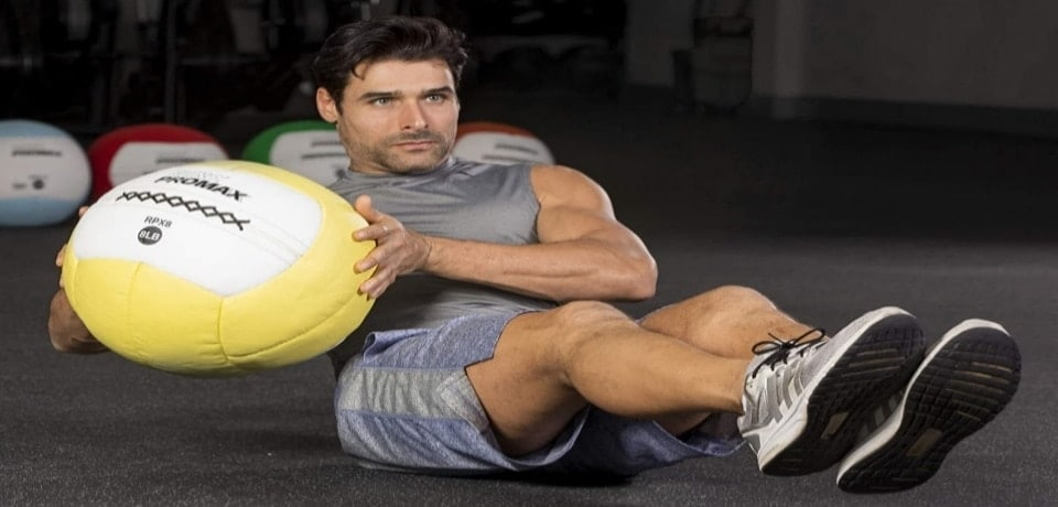 a man exercising with a medicine ball