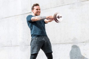 a man exercising with an adjustable kettlebell