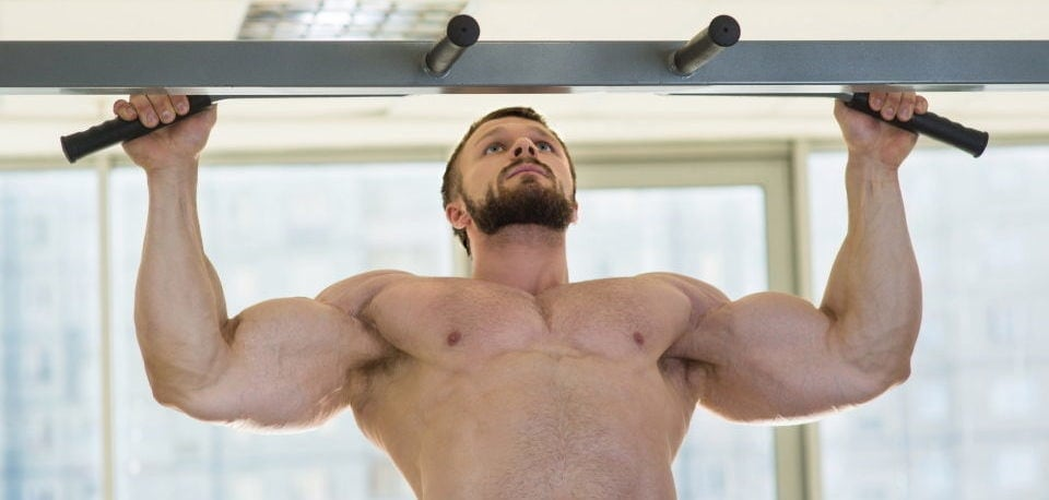 a man exercising with bar