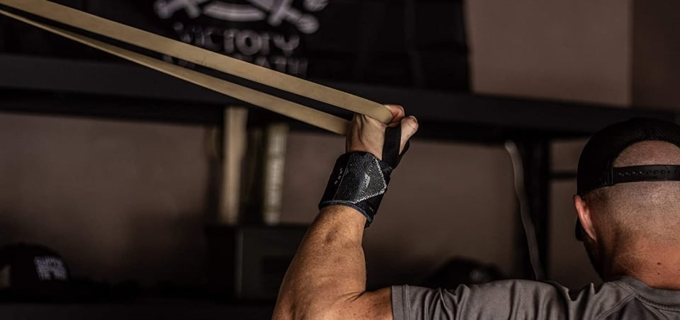 a man holding a pull up assist band with one hand