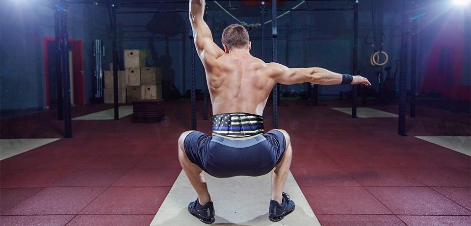 a man in the gym wearing a dip belt