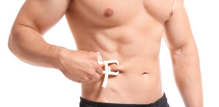 a man measuring his body fat