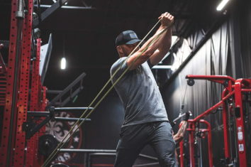 a man pulling hard on a pull up assist band