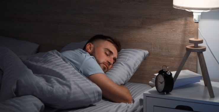 a man sleeping soundly in his room