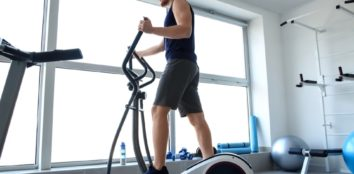 a man training on elliptical machine